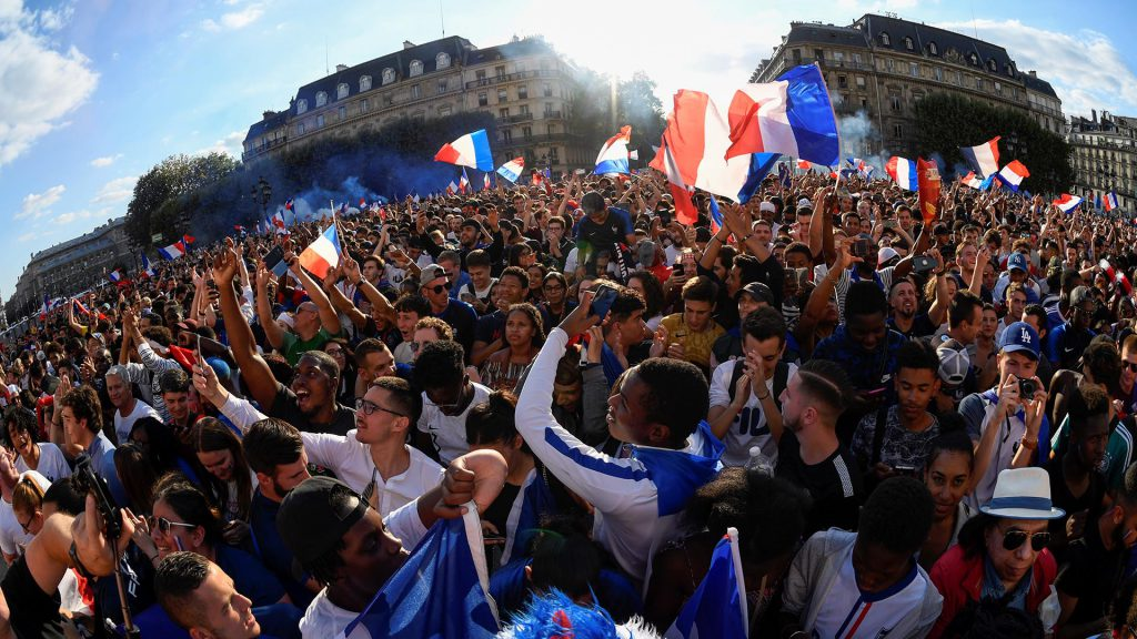 French football supporters shout slogans as they gather in a 'fan zone' in Paris on July 10, 2018, during the 2018 Russia World Cup football match between France and Belgium in Saint Petersburg.  / AFP PHOTO / Eric FEFERBERG